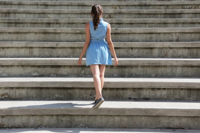 Woman with straight back skipping up stairs