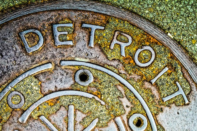 Weathered Detroit water meter cover.