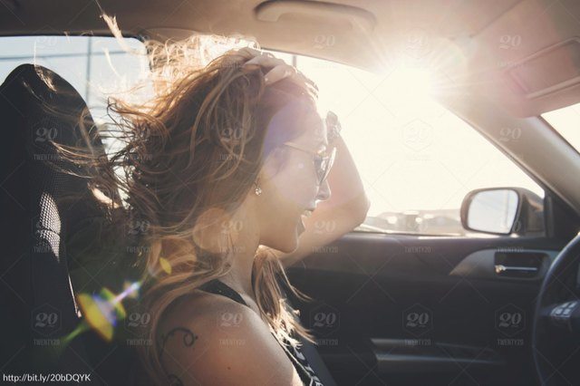 woman in vehicle listening to music