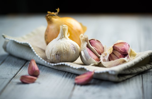 Fresh garlic on wooden background.