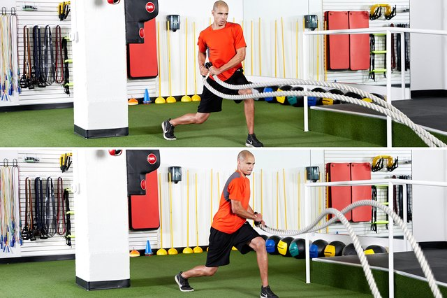 Man doing split squats with hip-toss rotation with the battle ropes