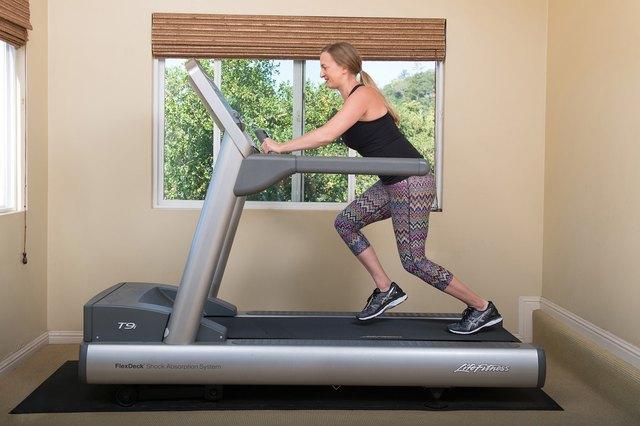 Fit woman walking on the treadmill