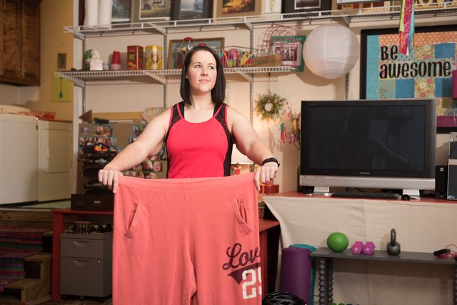 Lacey holds a pair of her old sweatpants.