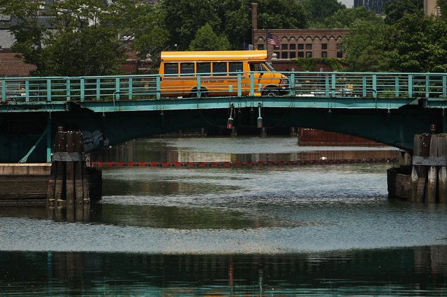 A bus travels on a bridge over Brooklyn's Gowanus Canal.