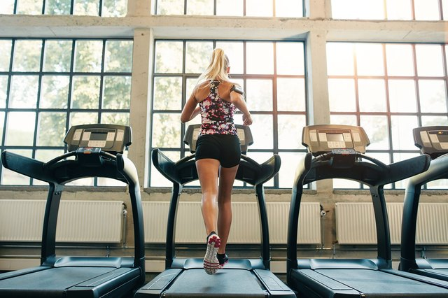 Woman exercising in a health club