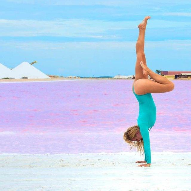 Rachel Brathen in Handstand pose.