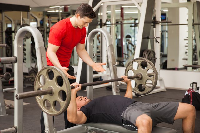 Men lifting barbell