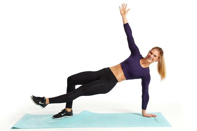 woman doing breakdance thruster move on yoga mat