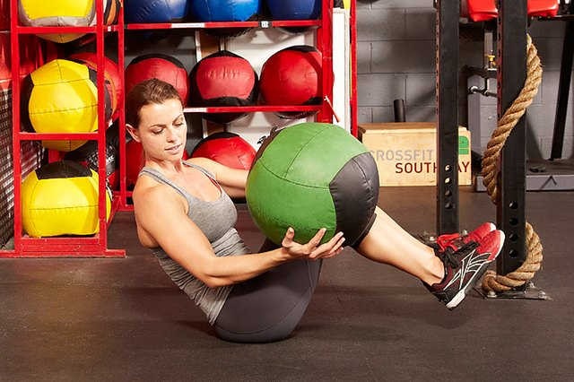 Target your core with Russian twists.