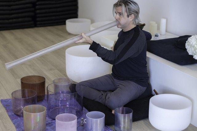 Sound healer plays his instruments at Unplug Meditation in Los Angeles.