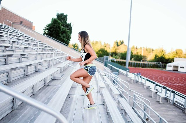 Woman running up stairs in morning workout.