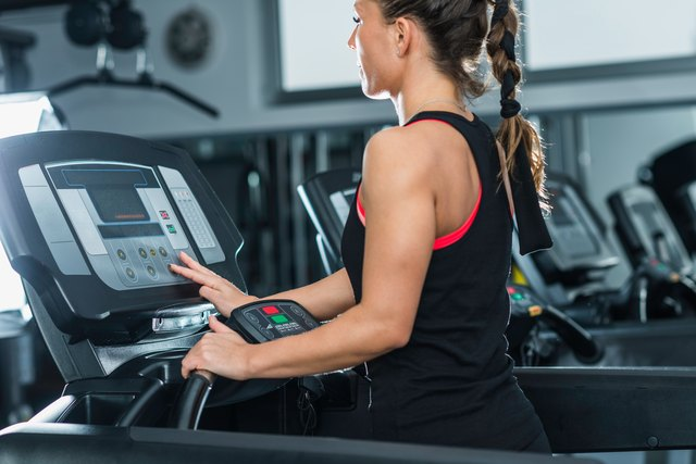woman walking on treadmill at the gym for exercise