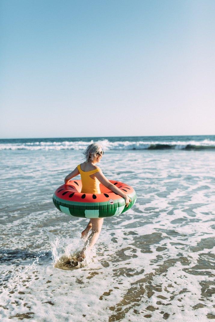 woman splashing around at the beach