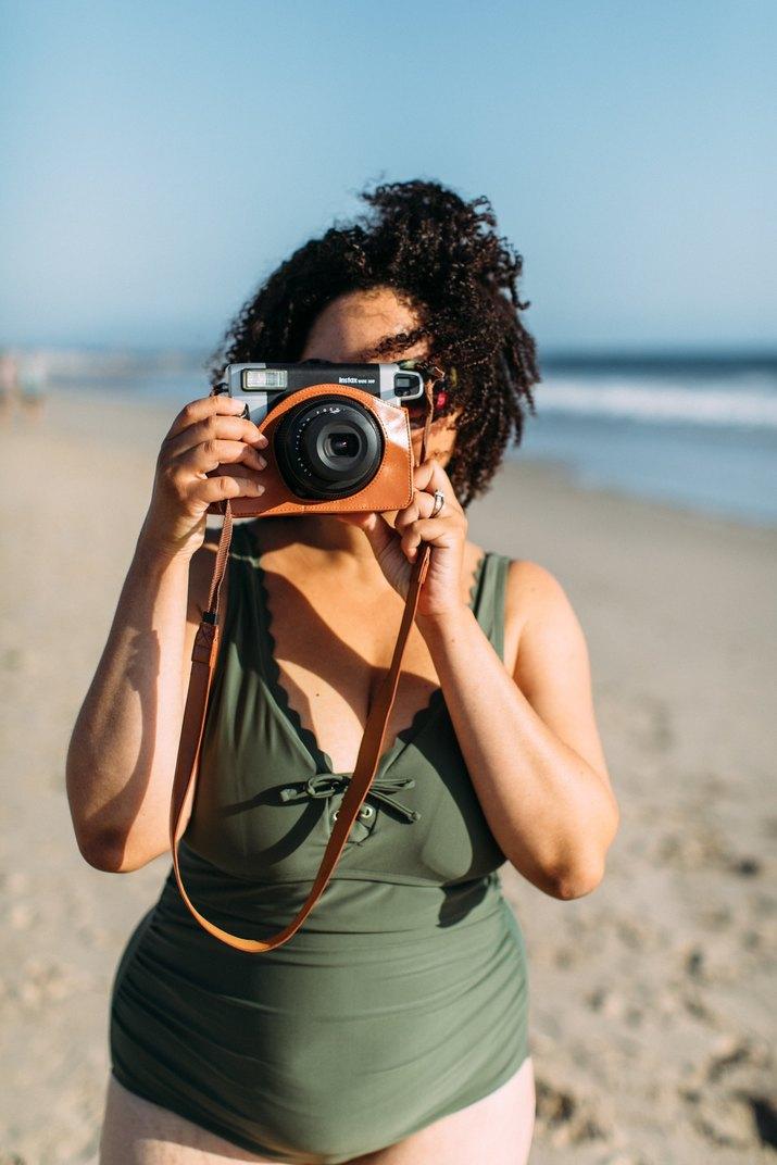 woman taking photos at the beach