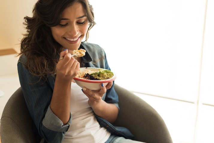 woman eating a salad bowl