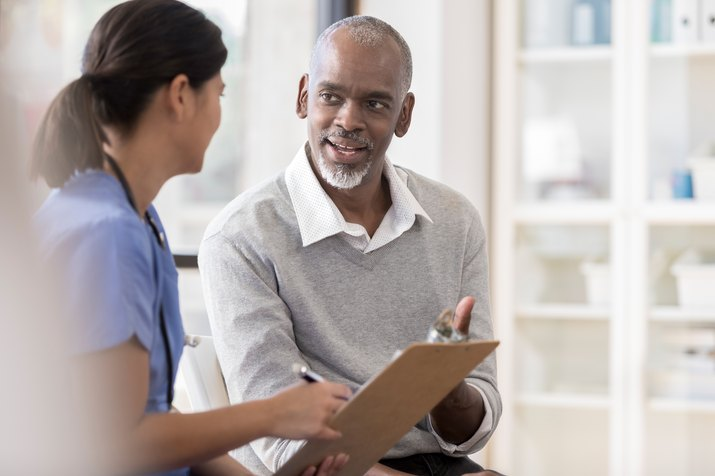 Senior man discusses fasting diet with doctor