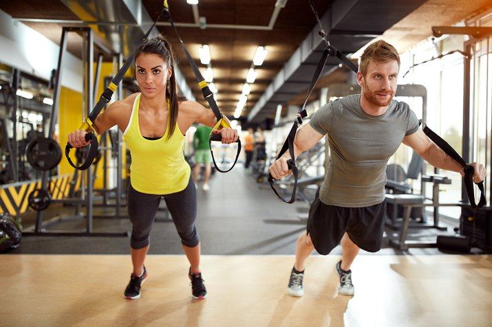 Couple on body training in gym