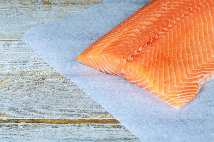 fresh raw salmon on wooden cutting board
