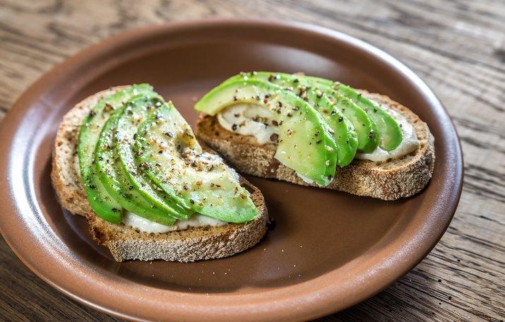 Toasts with tahini sauce and sliced avocado
