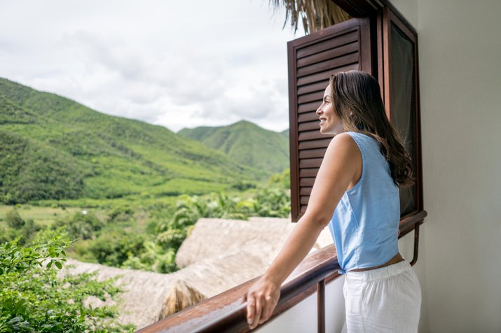 Woman traveling and enjoying the view from her hotel