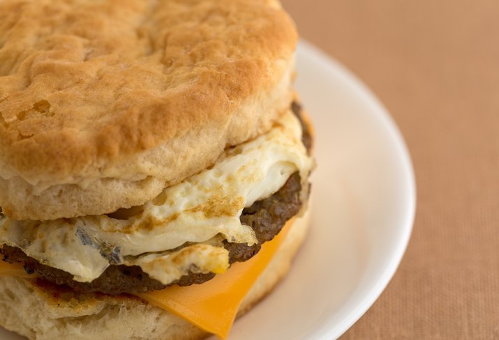 Close view of a breakfast sausage egg and cheese biscuit