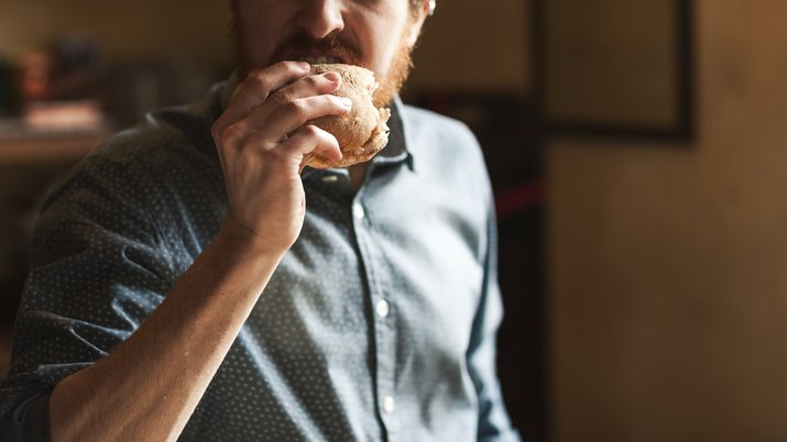 A man chewing his food slowly