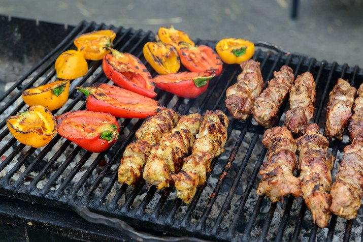 Meat and paprika on the grill. Popular street food.
