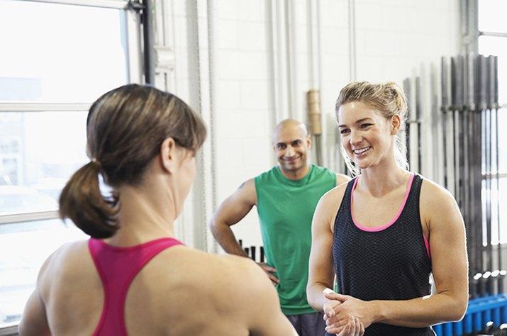 People talking at a CrossFit box