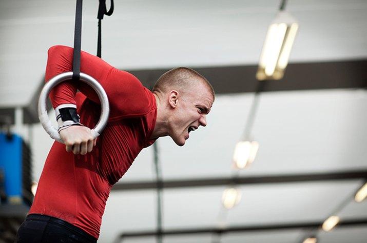 Man struggling through his CrossFit workout