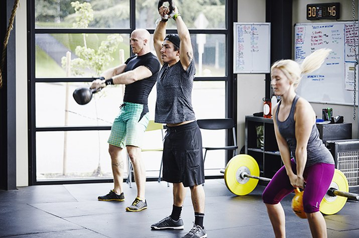 People doing a CrossFit workout with kettlebells