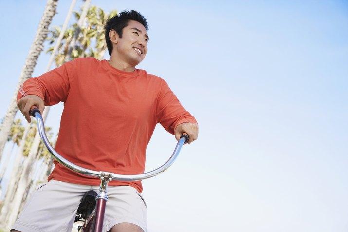 Asian man riding bicycle