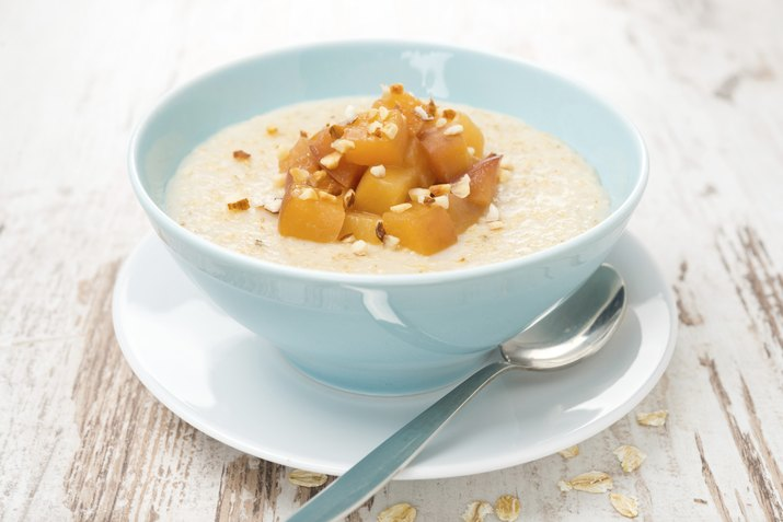 oatmeal with caramelized peaches in a bowl close-up