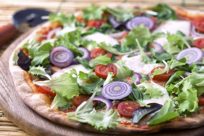 Pizza with salad and onion