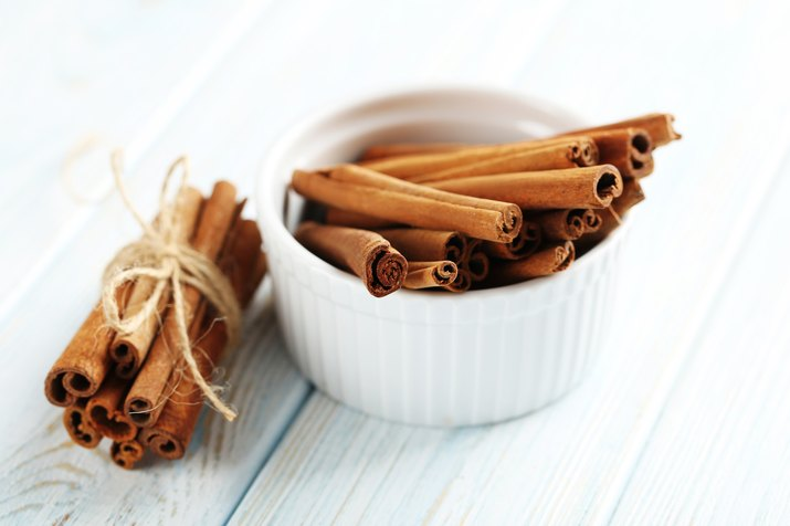 Cinnamon on a blue wooden background