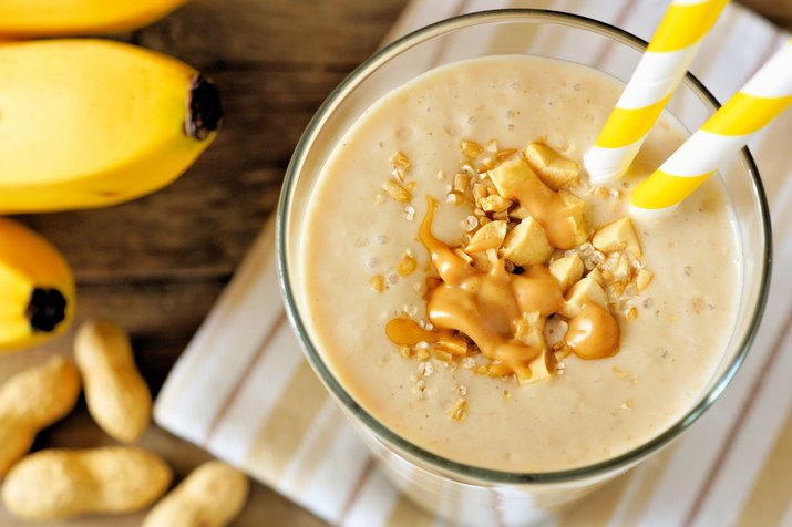 Peanut-butter banana oat smoothie close up, downward view
