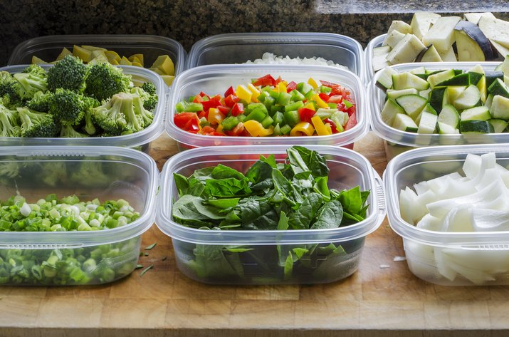 chopped vegetables in plastic containers