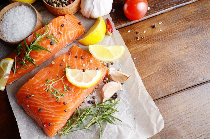 Raw salmon on baking paper for muscle building diet