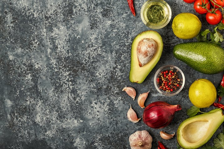 Fresh vegetables for cooking on dark background.