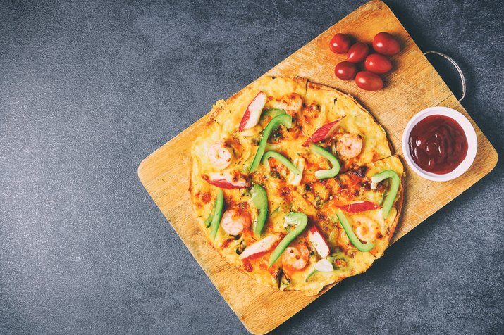 vintage filtered pizza with seafood paprika and tomatoes