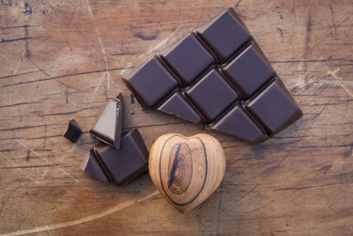 Still life with dark chocolate and wooden heart