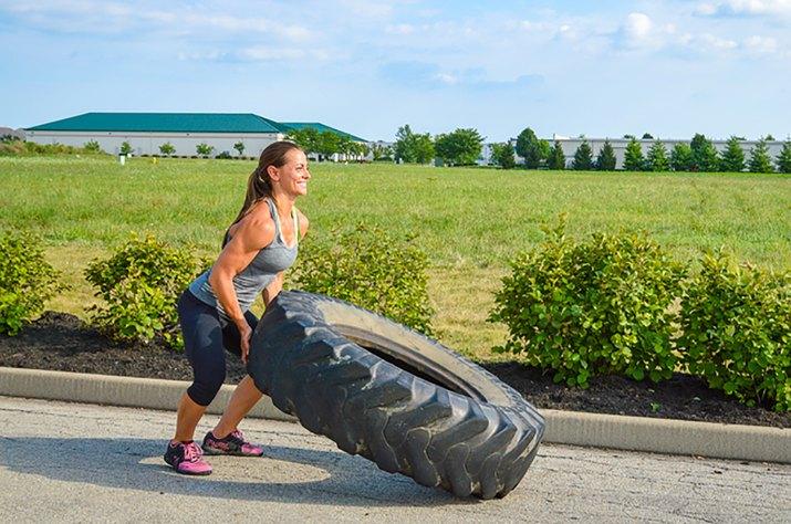 woman doing the tire flip