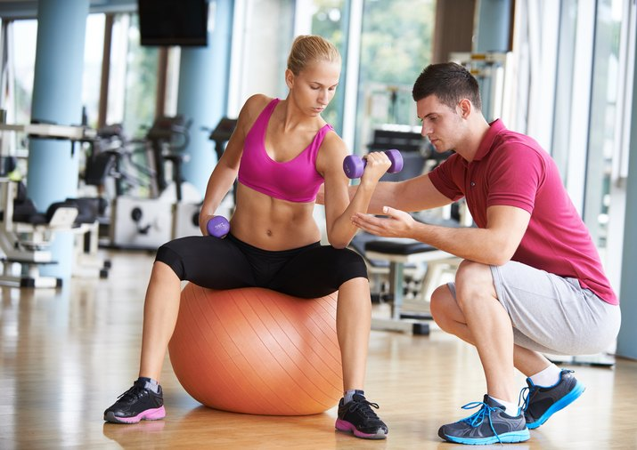 Woman Exercising with Training Coach