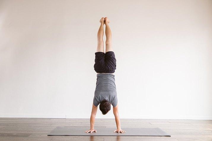 Tamal Dodge in Handstand pose.