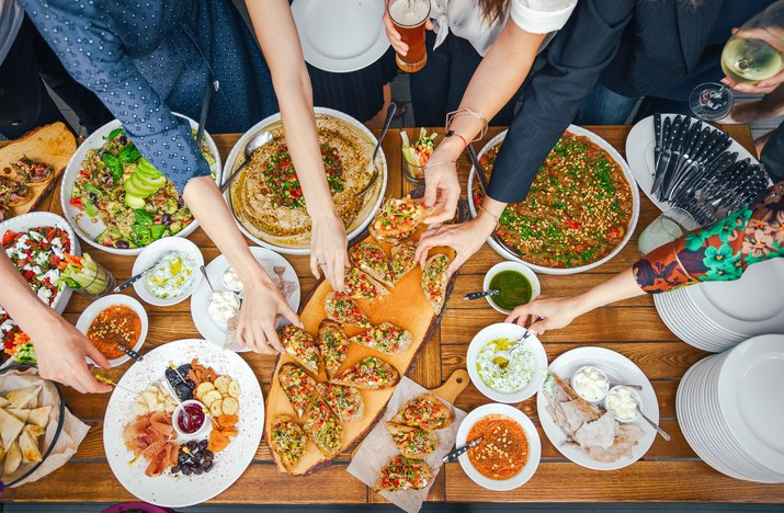 Friends Happiness Enjoying Dinning Eating Concept. Food Buffet. Catering Dining. Eating Party. Sharing Concept