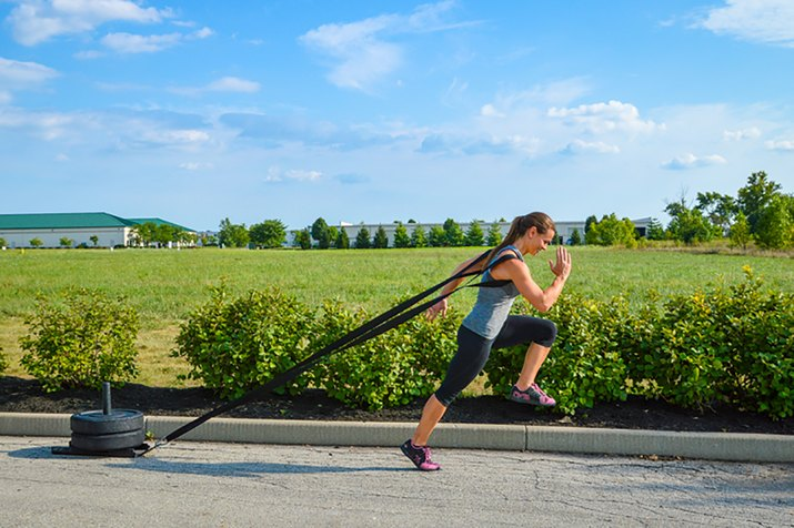 woman doing the sled pull