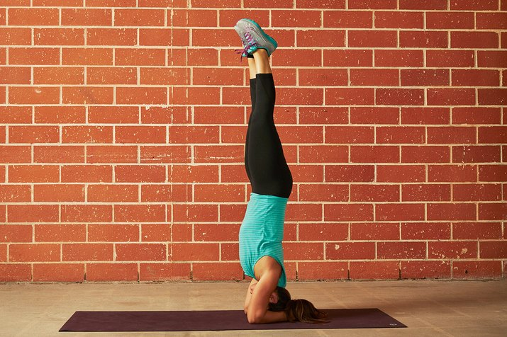 Woman Demonstrating a Headstand