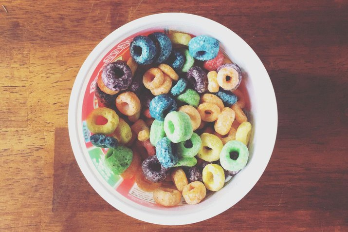 Bowl of sugary cereal on a wooden table