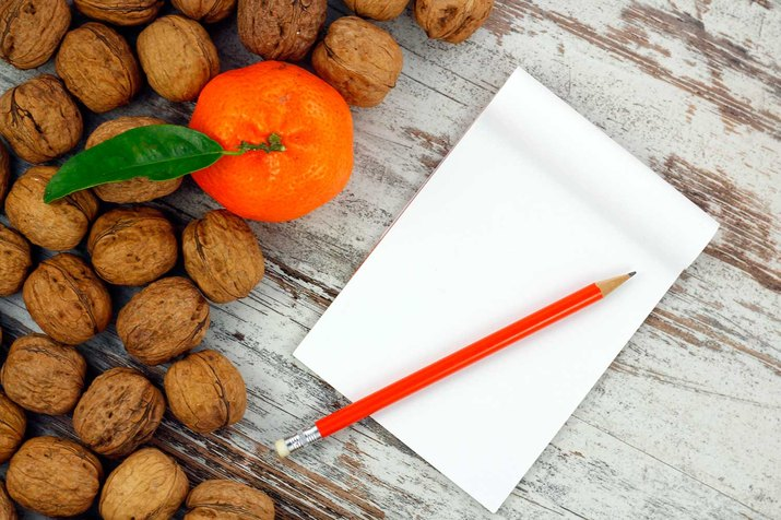 White notebook and fruit