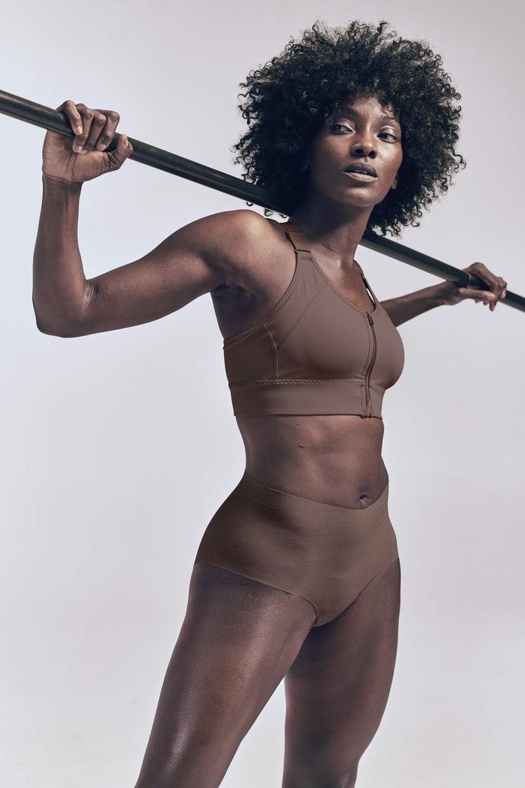 woman wearing athleta empower bra