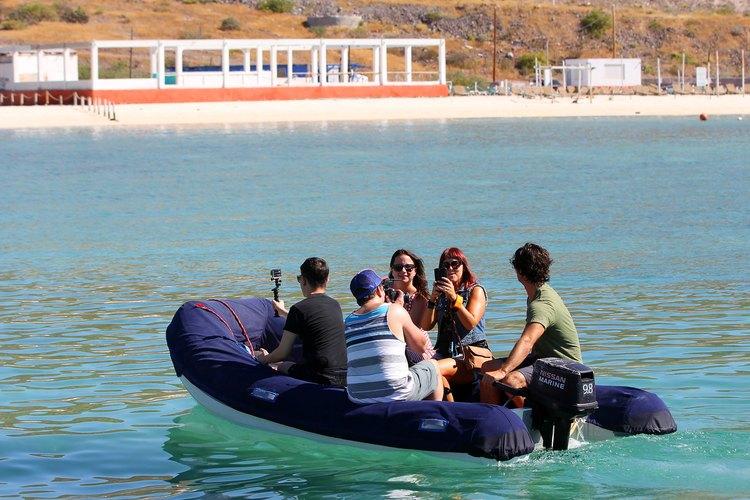 Team in the dinghy going to the lab